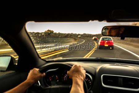 mid adult man driving car at
