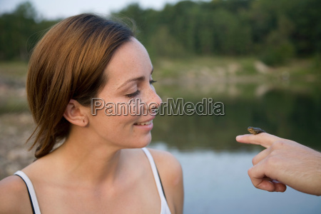 woman looking at frog