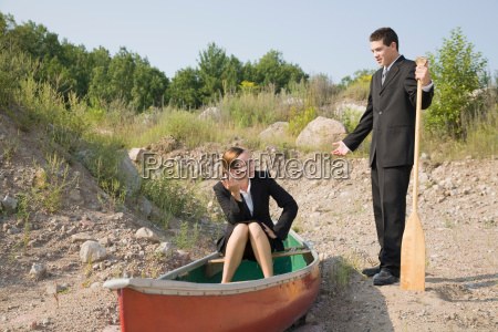 business people in stranded canoe