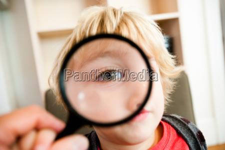 young boy looking at camera through
