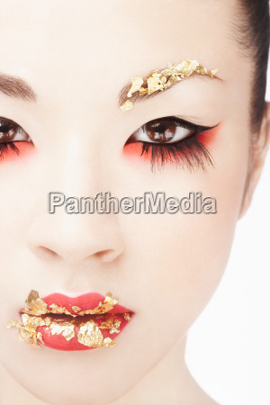 young woman with gold leaf make