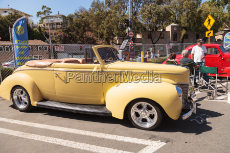 yellow 1940 ford deluxe cabrio