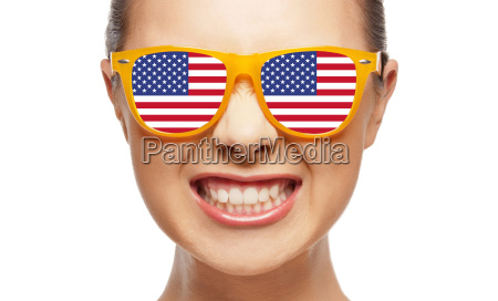 angry teenage girl in glasses with