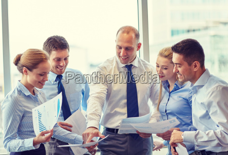 business people with papers talking in