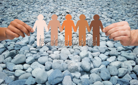 hands holding people pictogram over stone