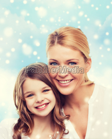smiling mother and little girl