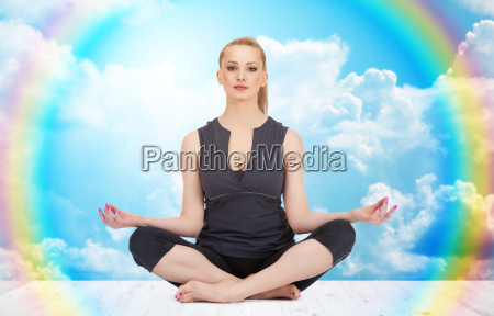 happy young woman meditating in yoga