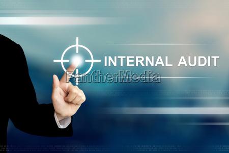 business hand clicking internal audit button
