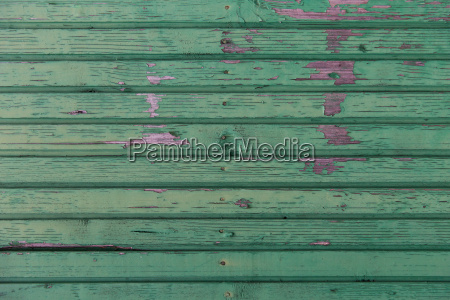 old wooden boards painted in green