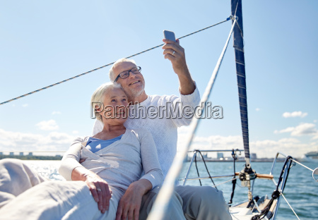 senior couple taking selfie by smartphone