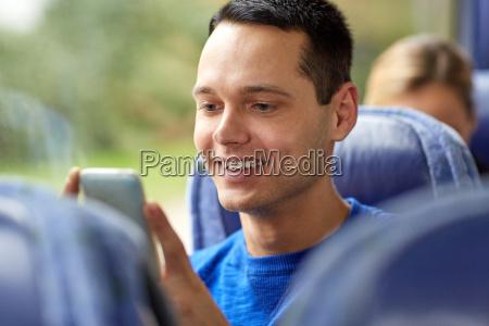 happy man sitting in travel bus