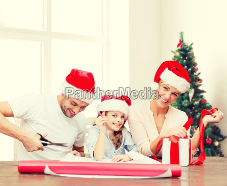 happy family in santa helper hats