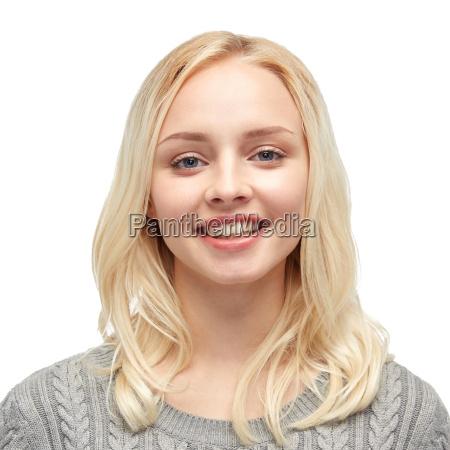 smiling young woman or teenage girl
