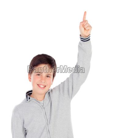 smiling teenage boy of thirteen asking