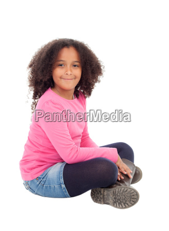 adorable african little girl sitting on