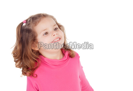 little girl in pink looking at
