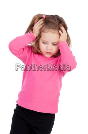 worried little girl in pink