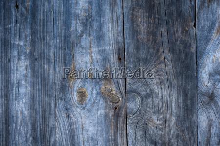 grauer alter holzhintergrund mit knoten und