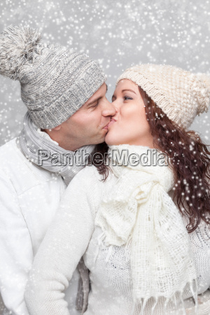 happy couple dressed in warm clothes
