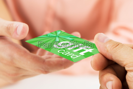person hands giving visiting card to