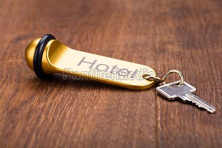 hotel key on wooden desk