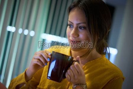 girl college student drinking coffee studying