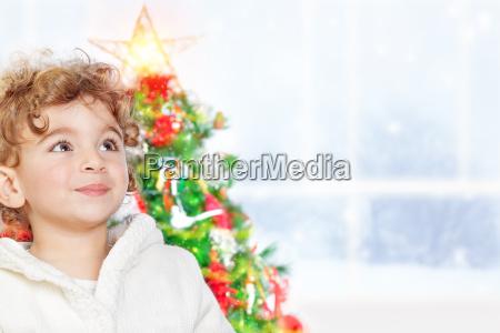 cute little boy near christmas tree