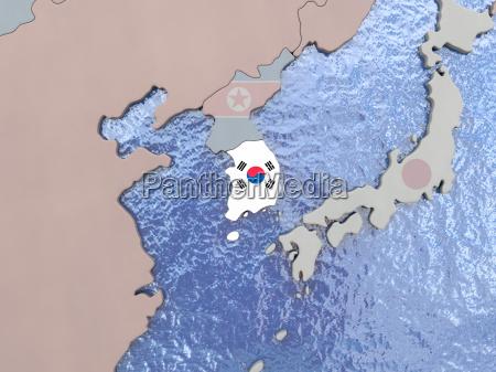 south korea with flag on globe