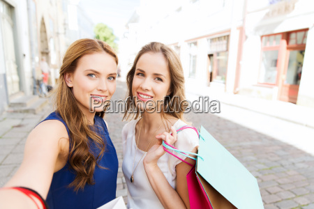women shopping and taking selfie by