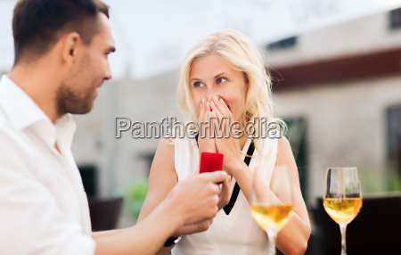 happy couple with engagement ring and