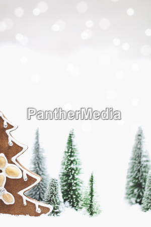 snowy winter forest with gingerbread christmas