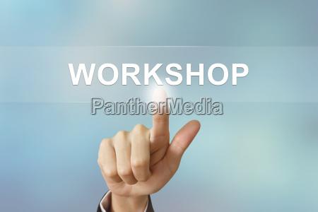 business hand klicken workshop button auf