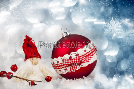 red christmas ball and santa figurine