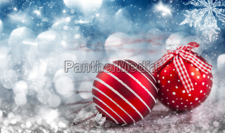 red christmas balls over sparkling holiday