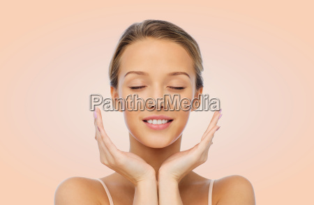 smiling young woman face and hands