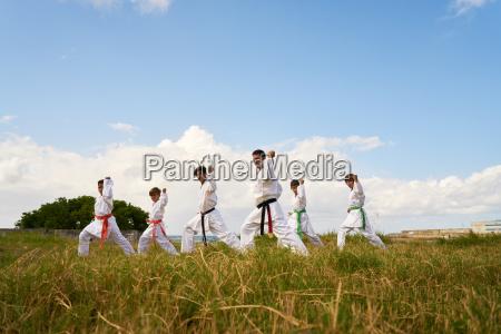 karate school with teacher and boys