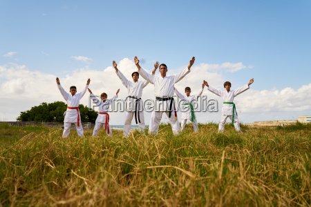 karate school with trainers and young