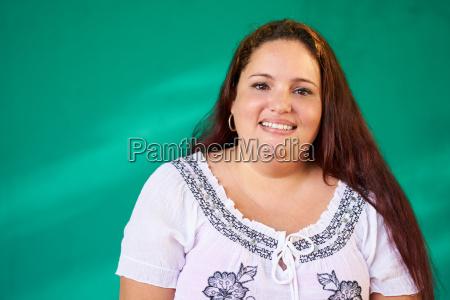 real people portrait happy overweight hispanic