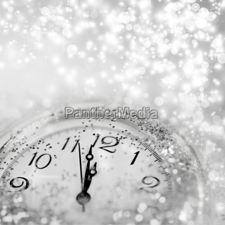 abstract holiday background with clock close