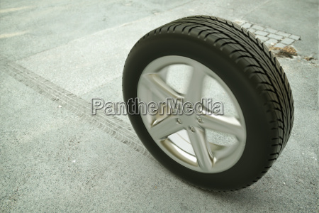 rolling car tire on street