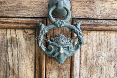 an antique pull handle knob on