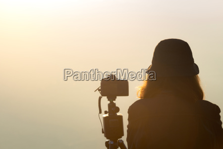 photographer woman waiting to take landscape
