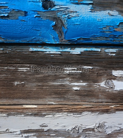 old wooden wall with chipped paint