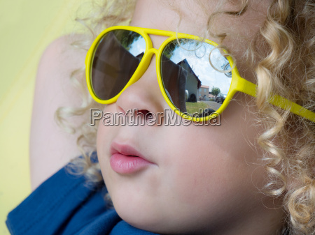 little blond boy with yellow sunglasses
