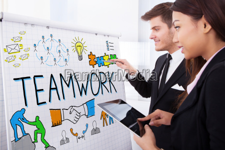business people analyzing graph in office