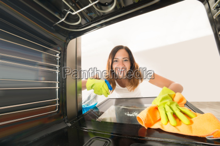 woman cleaning inside the oven
