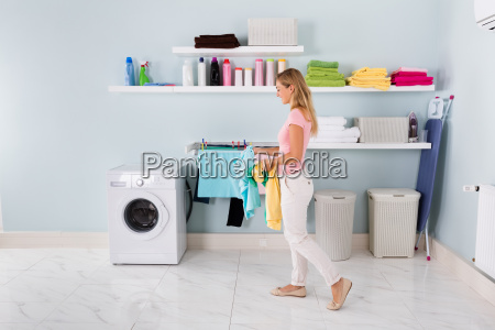 woman walking with clothes in utility