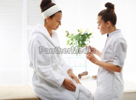 a beautician advises the customer on