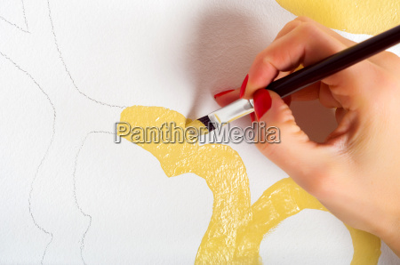 draw yellow painting on wall by