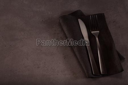knife and fork on napkin on